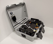 Specialized, custom computer gear mounted within travel case